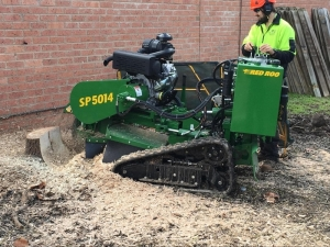 Jim's employee grinding a stump in Melbourne, Victoria